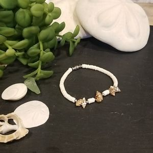 Puka shell bracelet with brown spotted shells